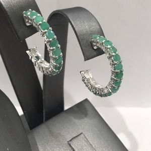 Sterling silver hoop earrings with green stones